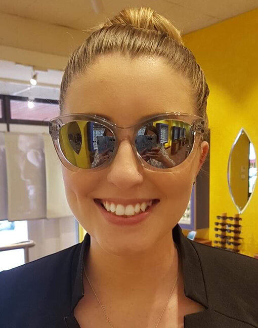 Macey wearing Safarro optical frames customised with Shamir mirror gradient lenses